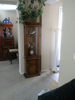 Tall wood cabinet with glass shelves & storage. Lights inside for Sale in Indio, CA