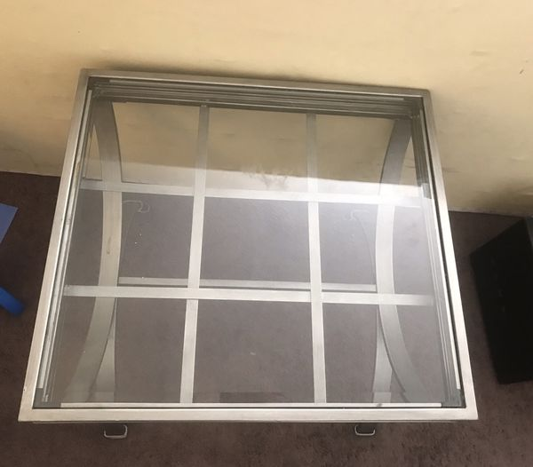 Glass top coffee table/center table