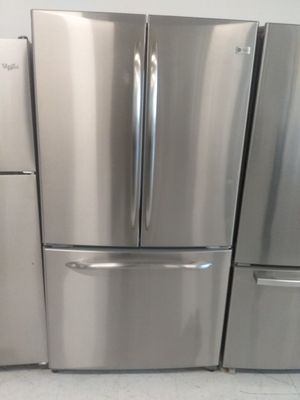 Ge French doors stainless steel refrigerator used good condition 90days warranty for Sale in Mount Rainier, MD