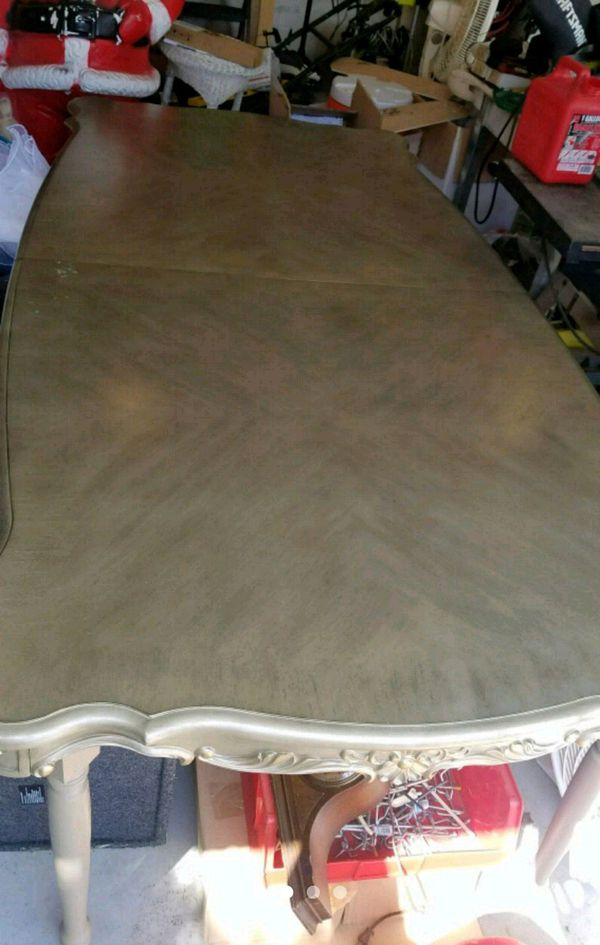 Dining room table with new leaf in box.