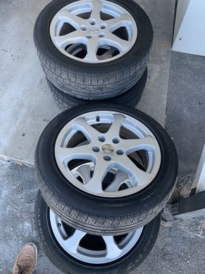 Nice set of wheels and tires for infinity or Nissan Altima 235/50/17 for Sale in Tampa, FL