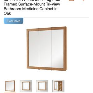 Home Decorators Collection 30-1/4 in. W x 29 in. H Fog Free Framed Surface-Mount Tri-View Bathroom Medicine Cabinet in Oak for Sale in Commerce, CA