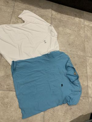 2 men's shirts XL Burberry and champion in white. for Sale in Las Vegas, NV