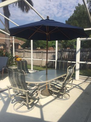 Leaders casual patio furniture. Table w/umbrella and 4 chairs for Sale in Oviedo, FL