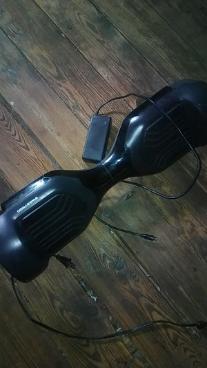 It's a black hoverboard had it for a year and a half blue lights Bluetooth connect for Sale in Brooklyn, OH