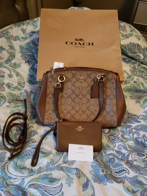 Authentic, never used Coach purse and wristlet. for Sale in Columbus, OH