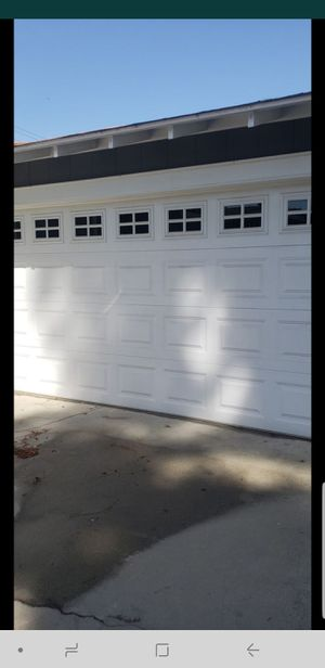 Double garage door with Motor, and remote complete working great for Sale in Downey, CA