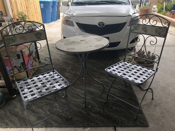 Garden table and 2 chairs ( chairs are cast iron and they fold)
