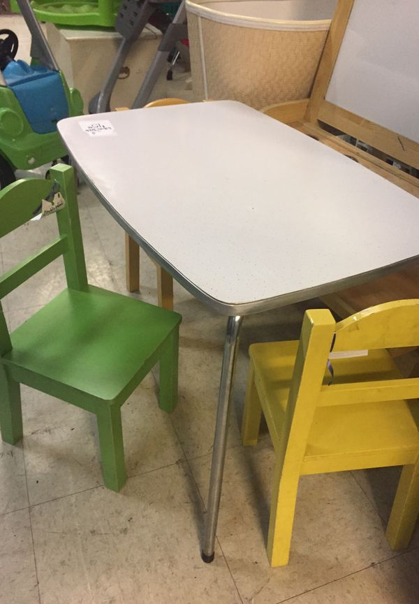 Kids activity table with three chairs
