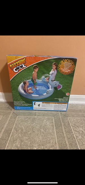 Sizzling cool elephant shape ring inflatable swimming pool with water spray. Brand new for Sale in Shelby Charter Township, MI