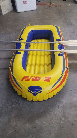 Inflatable raft with oars for Sale in Saint Paul, KS