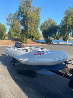 Saturn 12 ft inflatable boat with tonkatsu outboard and custom trailer for Sale in undefined