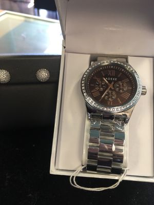 New chocolate adexe watch and diamond earrings new for Sale in Orlando, FL