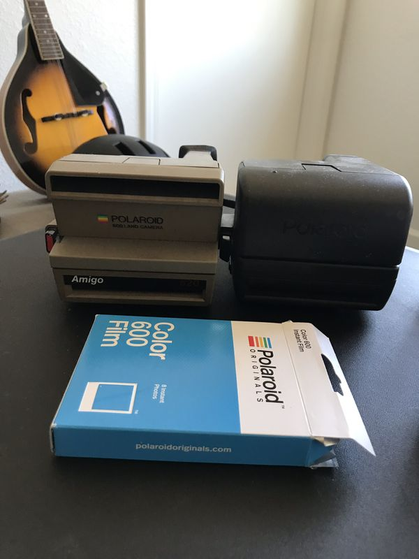 two polaroid cameras + film