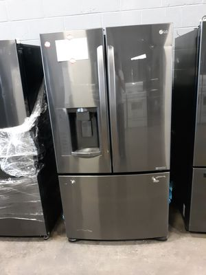 LG FRENCH DOOR REFRIGERATOR WITH WARRANTY, has some dents and one bottom handle is missing for Sale in Lorton, VA