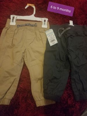 Size 6 to 9 months baby boy joggers one pair is brand new for Sale in San Antonio, TX