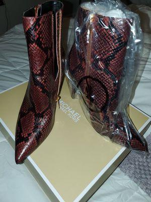 Michael Kors snakeskin boots for Sale in Riviera Beach, FL