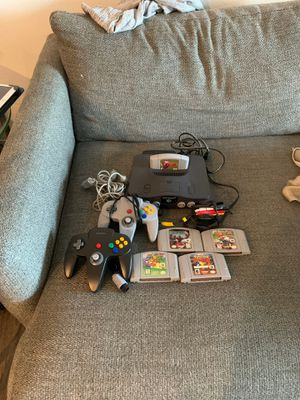 Authentic Nintendo 64 Console, 2 Controllers, Adapter, and 5 Games for Sale in Carlsbad, CA
