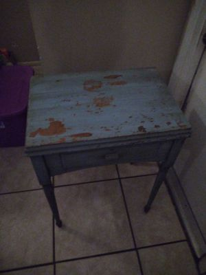 Singer sewing machine and cabinet for Sale in Sanford, FL