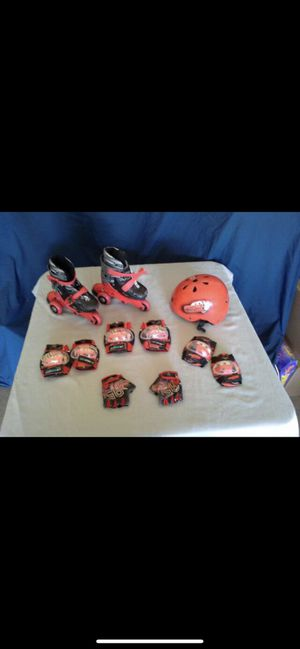 Cars adjustable skates - adjust size and wheels. Has helmet, gloves, elbow, and knee pads. for Sale in Wichita, KS