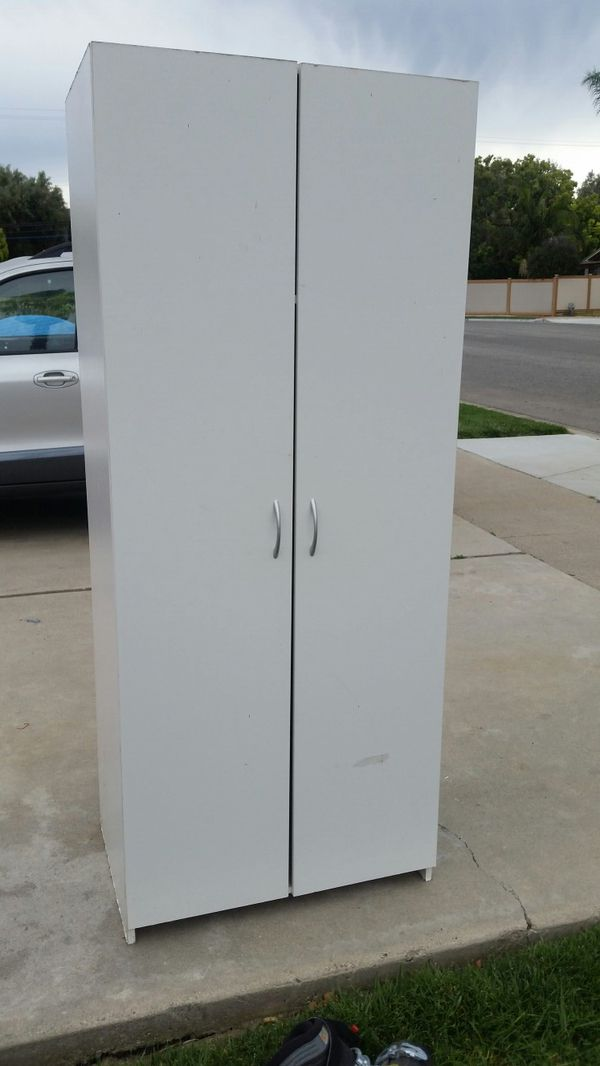 White tall wardrobe closet cabinet with doors and shelves