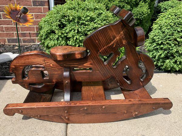 Custom made motorcycle rocker. Wood is heavy. Beautiful piece.