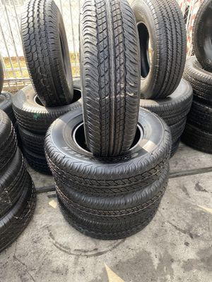 SET 245/75/16 DUNLOP SEMI NEW 95%TREAD LIFE $250 PRICE INCLUDES PROFESSIONAL INSTALLATION AND TAX for Sale in Long Beach, CA