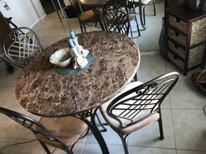 Dining/Kitchen Room Table & Chairs Materials: Marble & Metal Measurements: 30 inches tall 48 inches round for Sale in Palm Harbor, FL