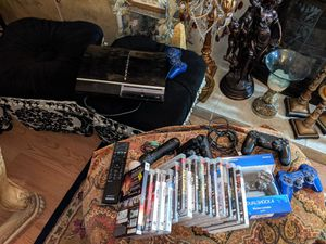 PS3 with 15 games 2 controller Motion controller Also have a guitar hero for Sale in Grand Terrace, CA