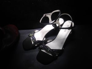 Size 9 and 1/2 women's heels bonded leather metaphor Christian brand black with rhinestones for Sale in Las Vegas, NV