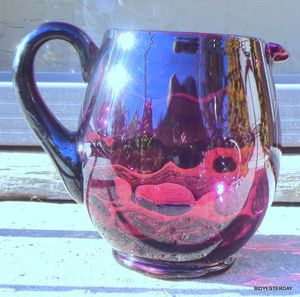 Antique reverse thumbprint hand blown amethyst glass water pitcher for Sale in Saginaw, MI