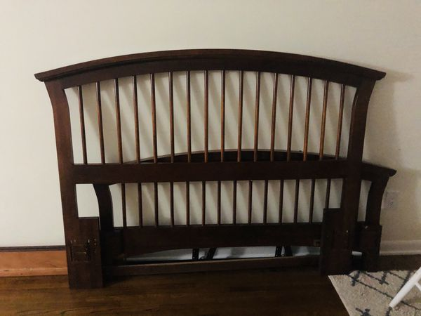 Queen size bed frame with queen mattress and boxspring.