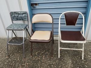 2 fold up metal chairs and a metal step stool for 25.00 for Sale in Gulfport, MS