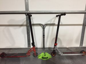 2 Pro Scooters and a set of bars and a scooter stand! for Sale in Sioux Falls, SD