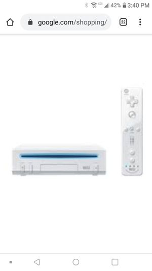 Wii counsel with one remote and wireless charger for Sale in Spokane, WA