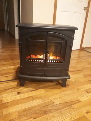 VERY NICE LIKE NEW ELECTRIC FIREPLACE HEATER WITH REMOTE CONTROL FOR SALE for Sale in Bellevue, WA