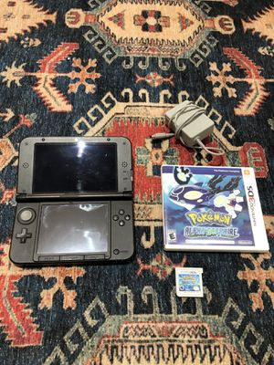 Nintendo 3DS XL Launch Edition Blue Handheld System and Charger + Pokemon Alpha Sapphire for Sale in Sunrise, FL