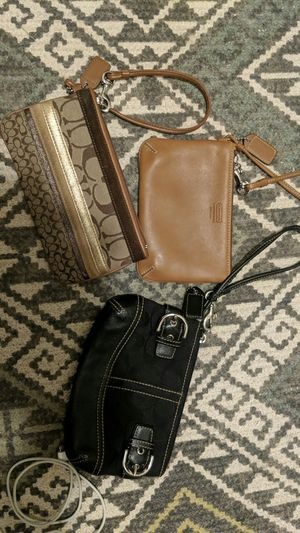 Coach wristlets in like new condition for Sale in Denver, CO