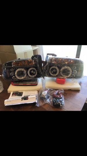 97-04 Dodge Durango/Dakota Angel Eye Halo & LED Projector headlights and LED tail lights for Sale in Helotes, TX