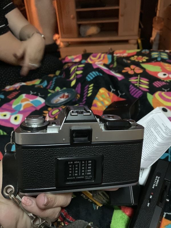 Minolta camera with accessories and 3rolls of film