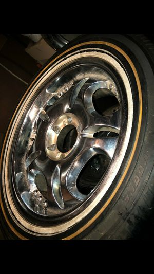 4 chrome rims paired with vogue tires for Sale in Columbus, OH