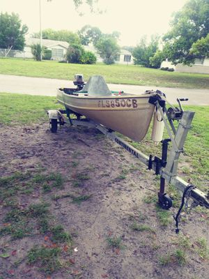 Aluminum v john boat w/trailer and motor for Sale in Port Richey, FL