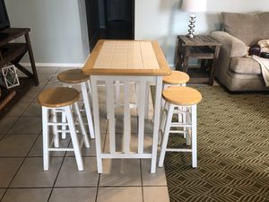 Bar height table with four stools for Sale in FL, US