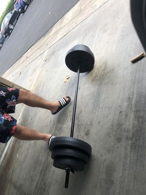 Weights (plates) with bar for Sale in Irvine, CA
