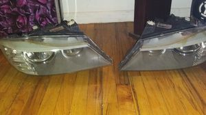 E90 BMW headlights and a Nissan radio $100 for Sale in The Bronx, NY