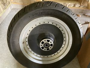 06 rear tire n rim off of sportster , great condition will fit other models , &100.00 for Sale in Peoria, IL