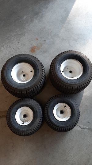 Complete set of riding lawn mower tires and wheels for Sale in Tacoma, WA