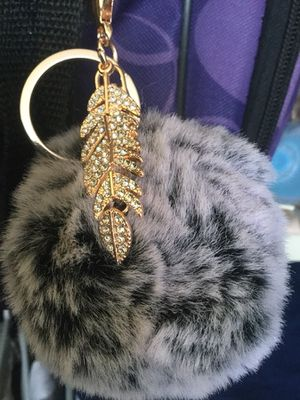 Keychain fur ball with feather ornament $12 / Purple Foxy keychain 🦊 $12 / Leather wallet keychain $20 for Sale in Alexandria, VA
