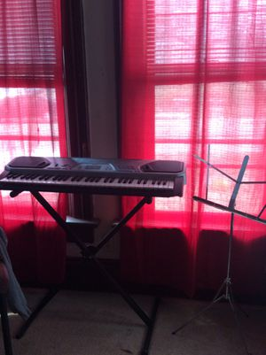 Keyboard with music stand for Sale in Moline, IL