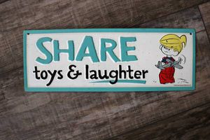 """12in collectible """"Share Toys & Laughter"""" Embossed Licensed Tin Sign. Dennis The Menace 2015 Comic Ketcham. 12.36"""" x 4.35"""".Pick up in East Pearland ne for Sale in Pearland, TX"""